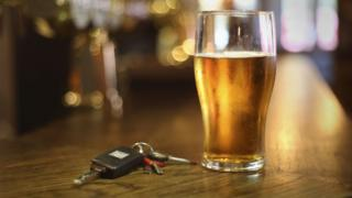 Beer and car keys on a table