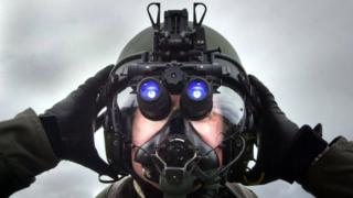 A pilot at RAF Lossiemouth, Scotland, wearing night vision device