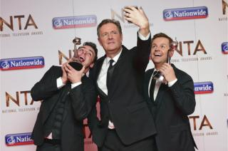 Piers Morgan taking a selfie with Anthony McPartlin and Declan Donnelly