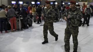 Soldiers patrol at Charles de Gaulle airport as part of security measures in the wake of the atrocity
