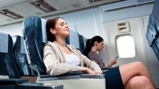 Women on plane seats