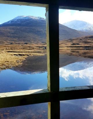 Mountain framed by window