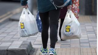 woman with Lidl bags