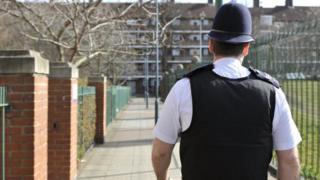Metropolitan Police officer on patrol