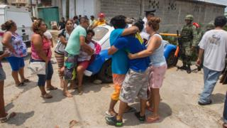 Relatives of five people murdered on a street cry in Acapulco's Icacos neighbourhood, Guerrero State, Mexico, on 17 April, 2016