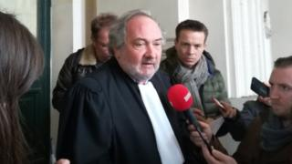 Belgian lawyer Vincent Lurquin speaks to reporters