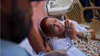 Asgari Begum, mother of Akhalaq, who was killed by a mob, mourns his death inside her house at Bisara village in Uttar Pradesh, India, October 2, 2015.