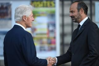US former President Bill Clinton is greeted by France's Prime Minister Edouard Philippe as he arrives to attend a church service for former French President Jacques Chirac on 30 September 2019.