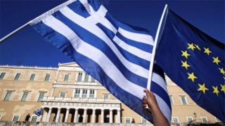 Greek and eurozone flag outside Greek parliament building