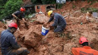 in_pictures Firefighters dig for victims of a mudslide in Guarujá, São Paulo state, Brazil. Photo: 3 March 2020