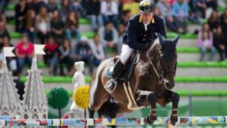 Олександр Онищенко на коні під час змагань