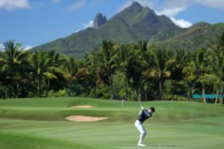 Dylan Frittelli of South Africa plays his second shot into the 15th green during the first round of the AfrAsia Bank Mauritius Open at Four Seasons Golf Club in Poste de Flacq, Mauritius - 29 November 2018