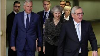 Theresa May with Jean-Claude Juncker and Michel Barnier in Brussels