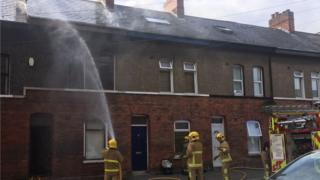 Fire fighters on the scene at Donegall Avenue