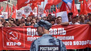 Russian Communist party supporters along with activists of the country's left-wing movements rally against the government's proposed reform to raise the pension age, Moscow, 28 July 2018