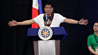 President Rodrigo Duterte speaks during a meeting with banana production businessmen in Davao city, in southern Philippines