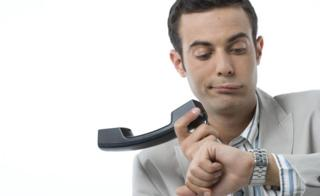 man fed up with waiting on phone