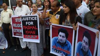 Pakistani protesters with banners demanding justice for Mashal Khan