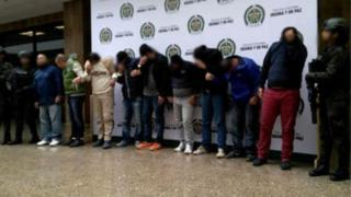 Handout picture by the Colombian Police showing the suspects with their faces blurred