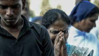 Relatives cry at the graveside during the funeral of a victim of the Easter Sunday Bombings at a local cemetery on April 24, 2019 in Colombo