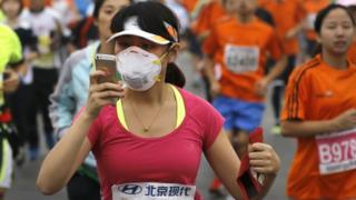 Chinese runner using a smartphone