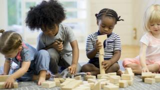 Toddlers with bricks
