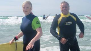 Joanne Young and John Hadley surfing while on holiday at Perranporth