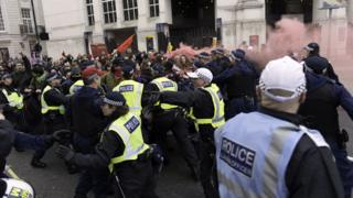 Police trying to control a crowd