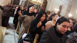 Coptic Orthodox Christian pray during a religious session by father Makary at St Mark Cathedral in Cairo December 26, 2014
