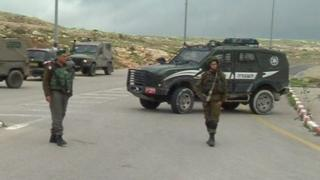 Israeli security forces outside the West Bank Anatot settlement where a Palestinian was shot dead following an attempted stabbing, 23 January 2016