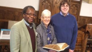 Bible custodian Dr Onesimus Ngundu, Mary Thomas and local minister Rev Carwyn Siddall