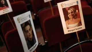 Name tags at the Royal Albert Hall showing Rami Malek and Margot Robbie