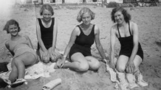 Women on beach in the 1930s