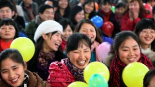 In this picture taken on January 15, 2011, workers gather for a Chinese new year dinner provided by their employer