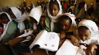 Girls reading books in a classroom in El-Riyadh camp in Geneina, West Darfur, Sudan - Wednesday 8 February 2017