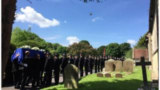 Funeral procession at St Mary's Church in Chieveley