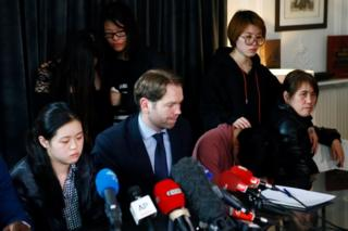 French lawyer Francois Ormillien, center, attends a press conference with the daughter, left, and family members of a Chinese man Shaoyo Liu who was killed Sunday in a deadly police raid in Paris, Wednesday, 29 March 2017.
