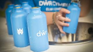 Welsh Water bottles being filled with water at a festival
