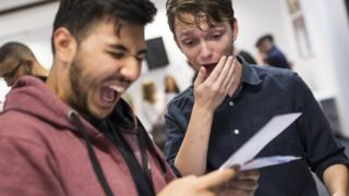 Two male student getting their A level results