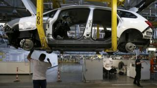 Employees work on the Astra production line at the Vauxhall Motors plant in Ellesmere Port