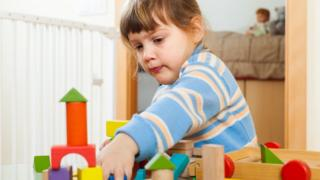 3 year old girl building