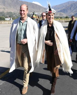 The Duke and Duchess of Cambridge arrive in traditional dress at Chitral in Pakistan