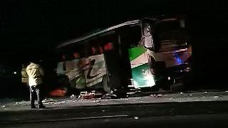 Video grab shows crashed bus by side of the road