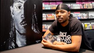 Jme signing copies of his album Grime MC