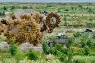 in_pictures Armoured tanks launch smoke grenades