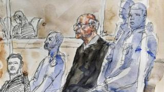 A court sketch shows Joël Le Scouarnec, (centre) sitting in the courtroom in Saintes, France. Photo: 13 March 2020