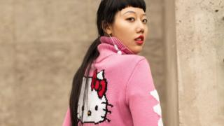 Paris fashion week model wearing Hello Kitty jumper