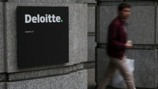 Man walks out of Deloitte office