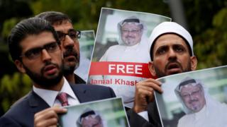 Human rights activists and friends of Saudi journalist Jamal Khashoggi hold his picture during a protest outside the Saudi Consulate in Istanbul, Turkey October 8, 2018