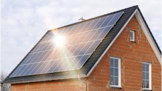 A house roof covered in solar panels